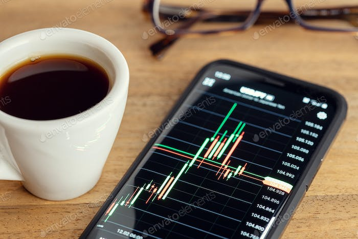 Stock market trading on portable device concept