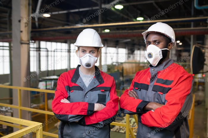 Workers in respiratory masks