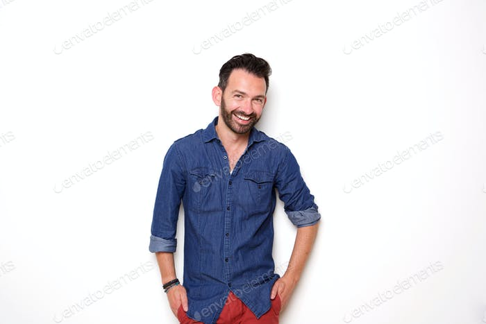 Happy mature fashion model posing with hands in pocket