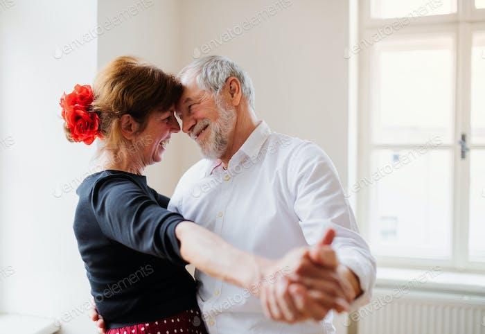 Senior couple attending dancing class in community center