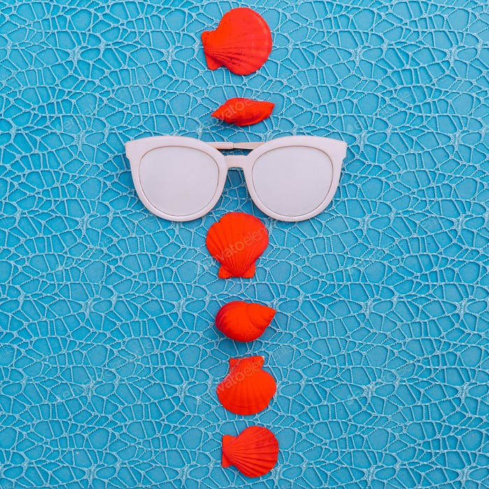 Sunglasses and pink seashells. Beach Fashion Art