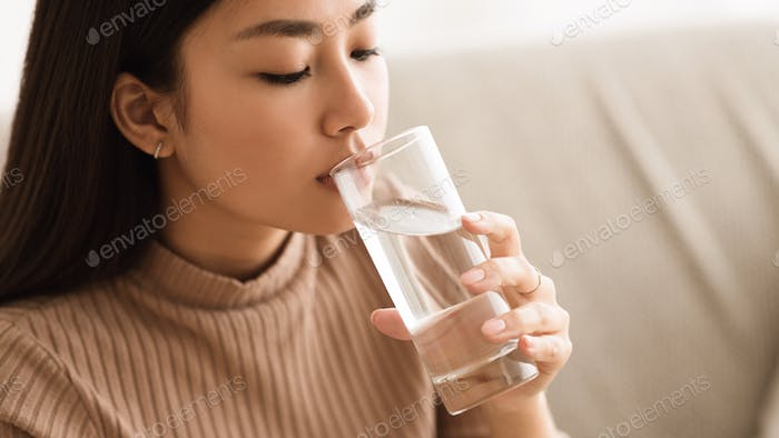 Girl Drinking Clean Mineral Water from Glass