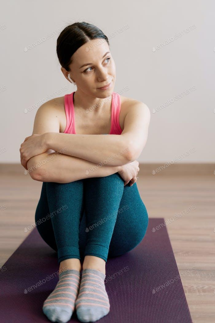 Portrait caucasian woman practicing yoga at home