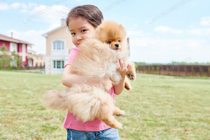 Asian Girl Holding Pet Dog