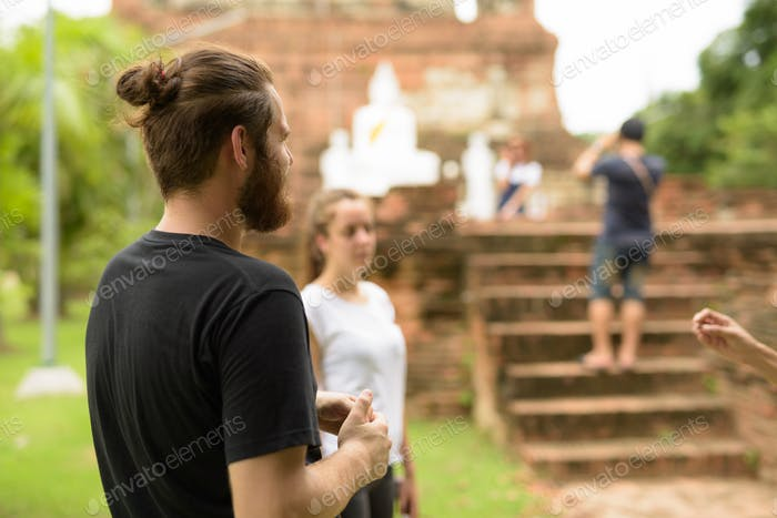 Young tourist couple having vacation together in Ayutthaya, Thai