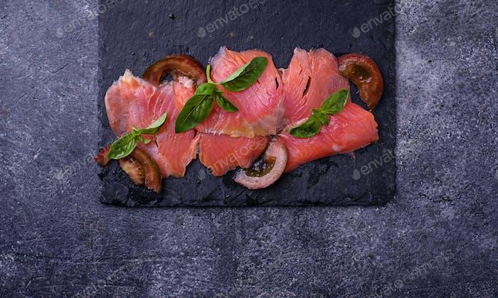 Salmon carpaccio with basil and tomato