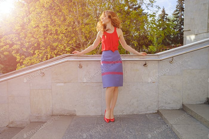 Beautiful woman walking up stairs