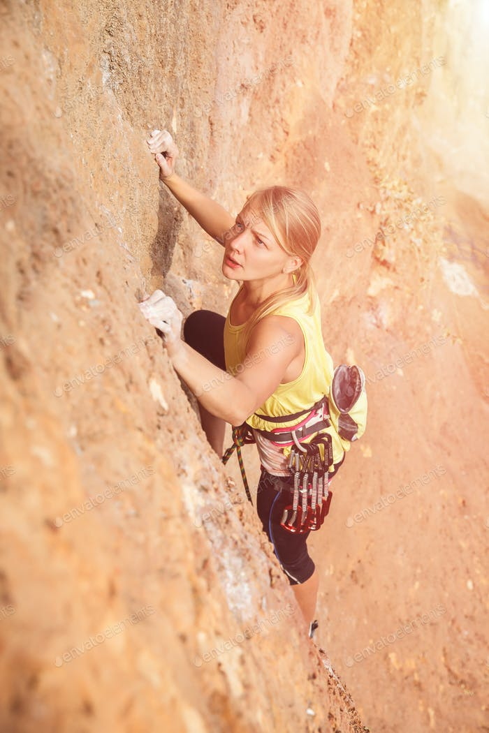 Female rock climber on the wall