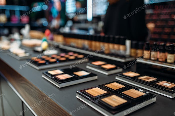 Powders collection, showcase in make-up shop