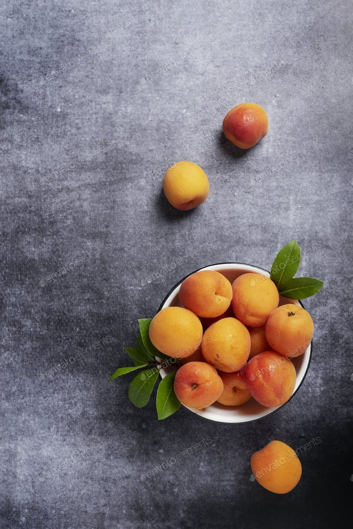 Sweet fresh apricots in the white bowl