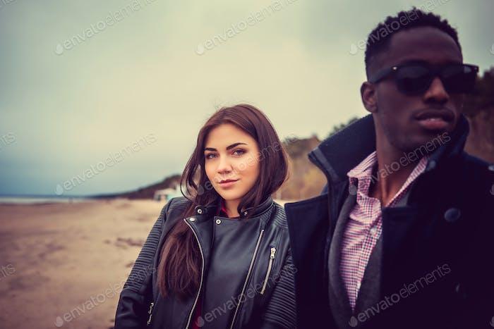 Portrait of black man and caucasian woman.