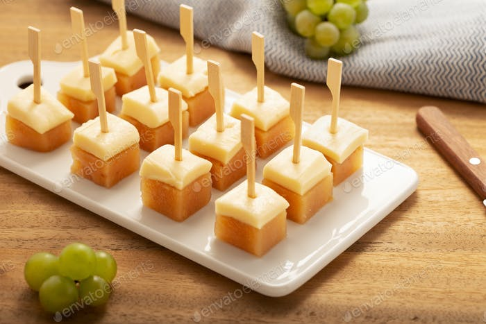 Cheese with jelly quince on tray