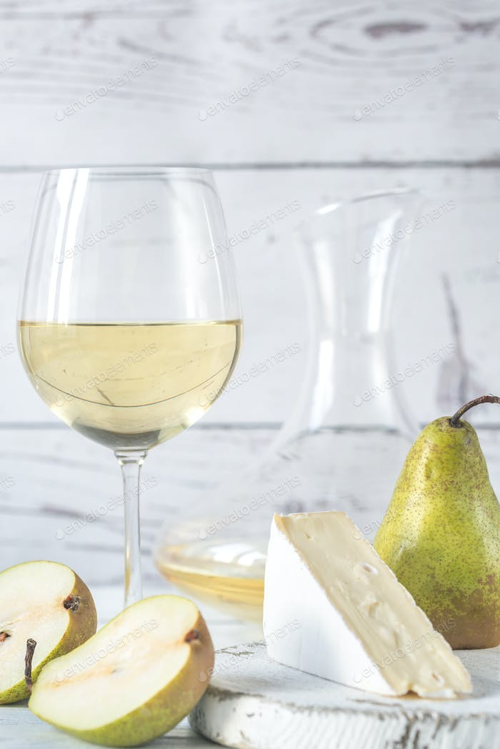Glass of white wine with cheese and pears