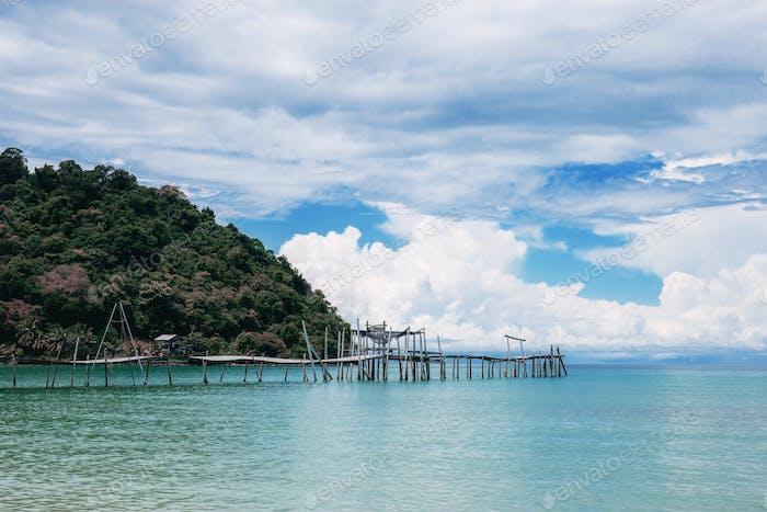 Bridge on beach at sky