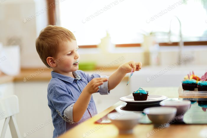 Cute child tasting cookies