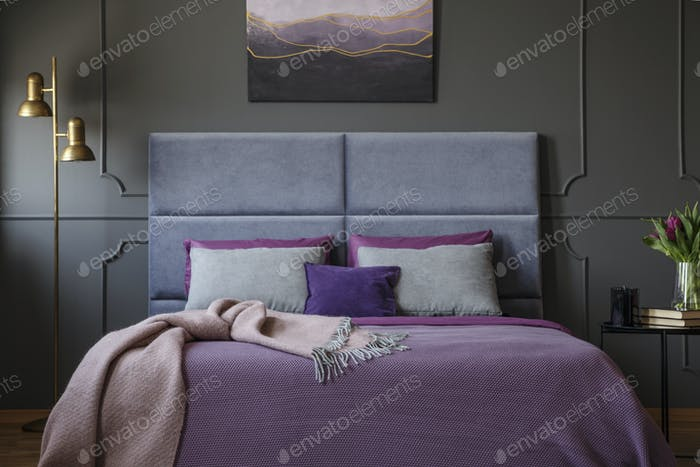 Close-up of stylish, luxurious hotel room interior with pink bla