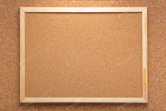 cork board in wooden frame as background