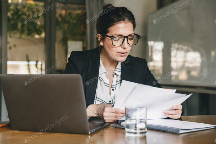 Photo of serious manager or director woman wearing formal clothi