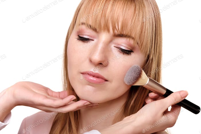 Process of making makeup. Make-up artist working with brush on m