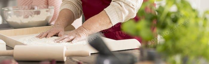 Grandmother preparing food