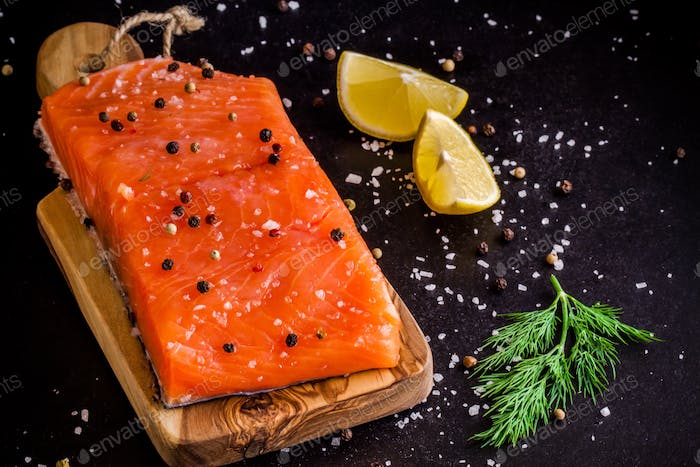Fresh salmon fillet with lemon and dill