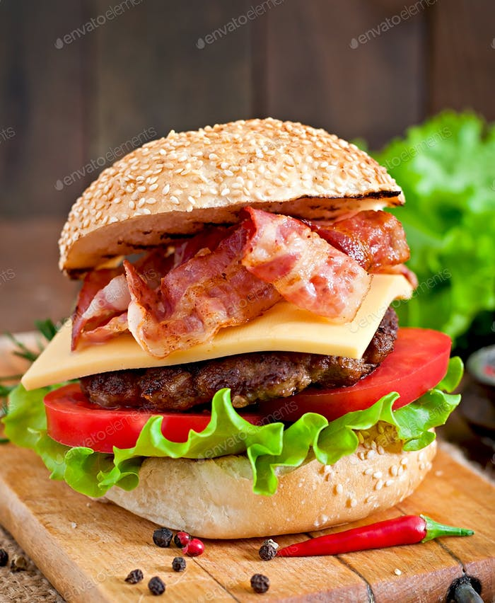 Big sandwich - hamburger burger with beef, cheese, tomato and fried bacon