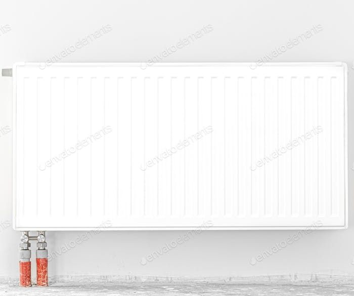 Radiator in front of a white wall. Space for text.