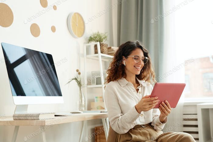 Woman Taking Part In Online Meeting