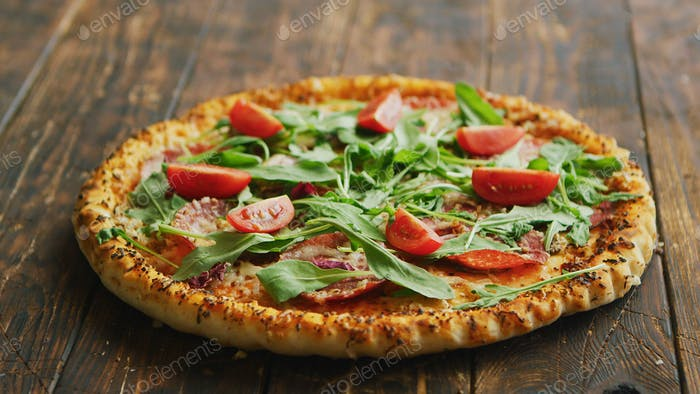 Thumbnail for Delicious italian pizza served on wooden table