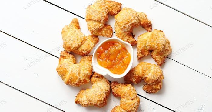 Croissants lying around jam