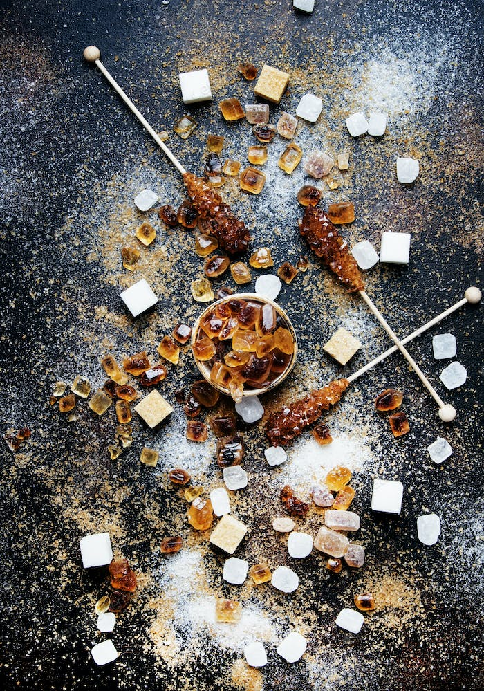Sweet food background, assorted white and brown sugar