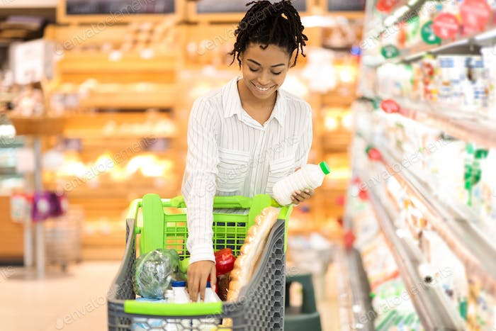 African American Lady Buying Food In Grocery Shop