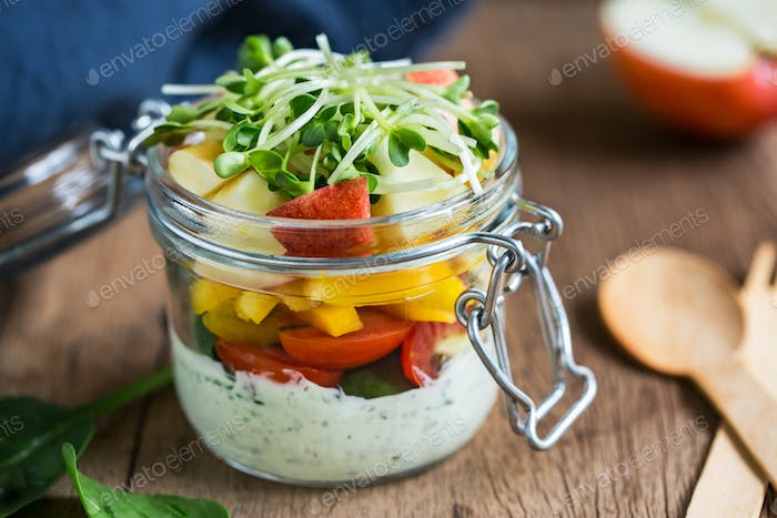 Spinach,apple and tomato salad in a jar