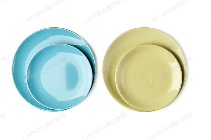Green and blue plates on a white background. Isolated.
