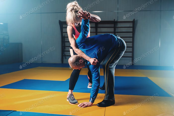 Male and female fighters, self defense technique