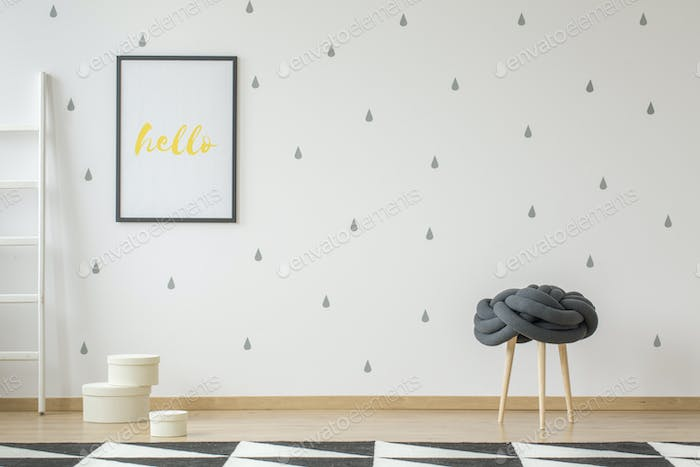 Poster on wallpaper in teenager's room interior with stool and g
