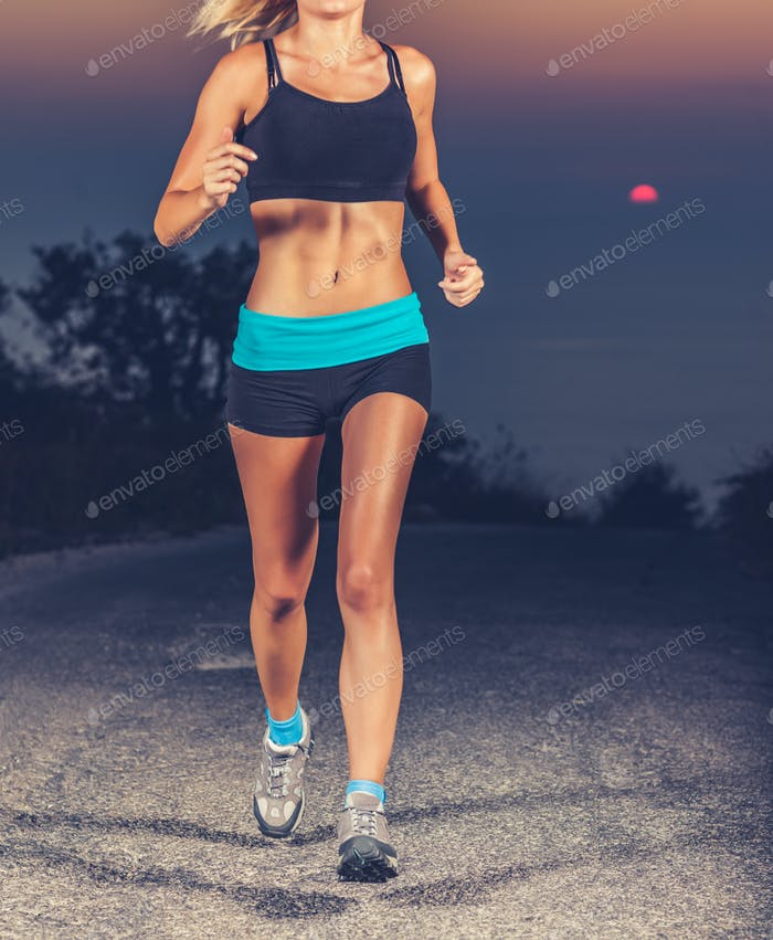 Athletic woman jogging outdoors