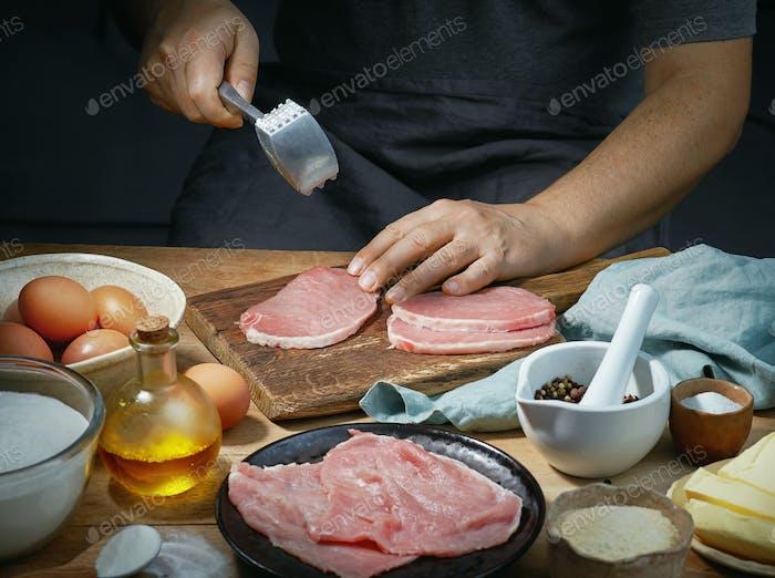 cook is preparing meat