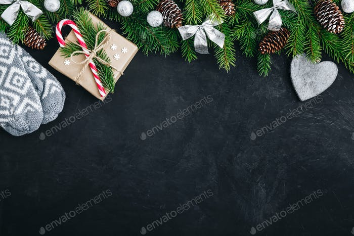 Christmas festive background with christmas tree branches, fir cones, gift box