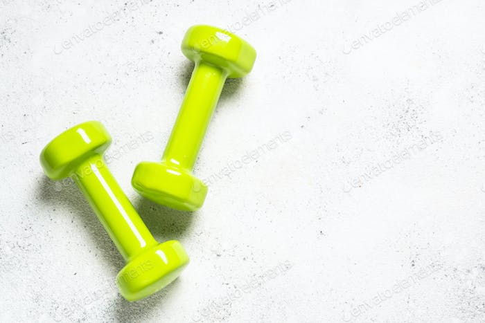 Dumbbells on white background top view