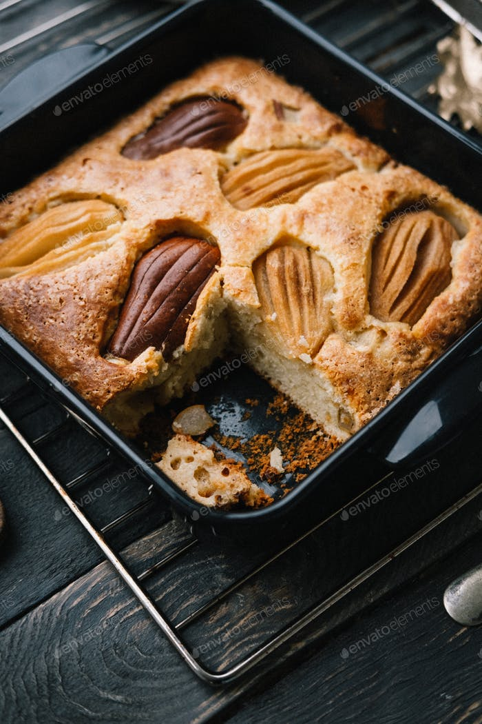 Fall french pear cake in a black ceramic bakeware