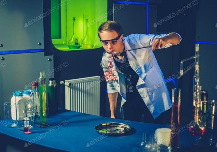 Young chemist making experiments in laboratory