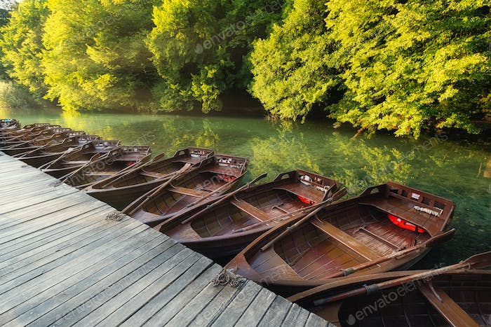 Boats in Plitvice lakes, Croatia. National Park in summer. Lakes among the forest.