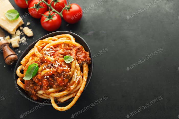 Tasty pasta bolognese with cheese and basil