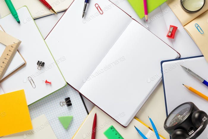 school accessories and open notebook or book