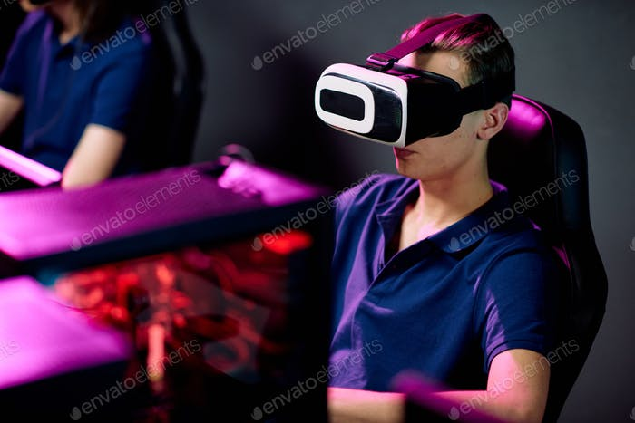 Gamer in Virtual Reality Headset