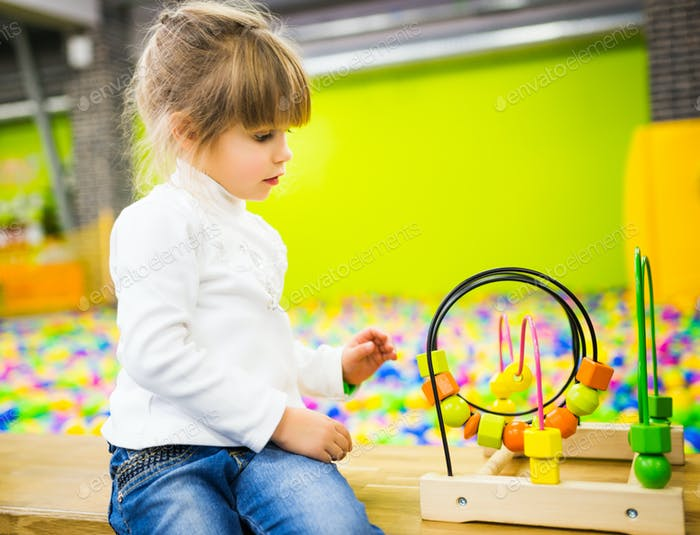 Girl playing with a developmental toy