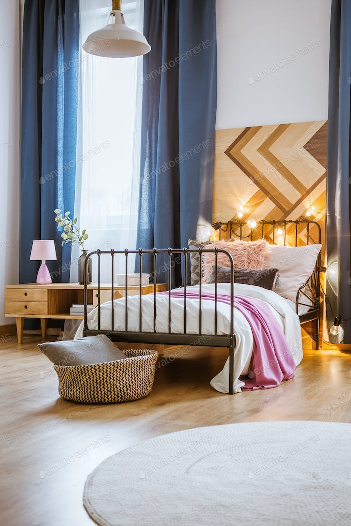 Metal bed in modern bedroom