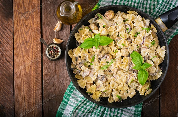 Pasta with meatballs and mushrooms in creamy sauce. Flat lay. Top view