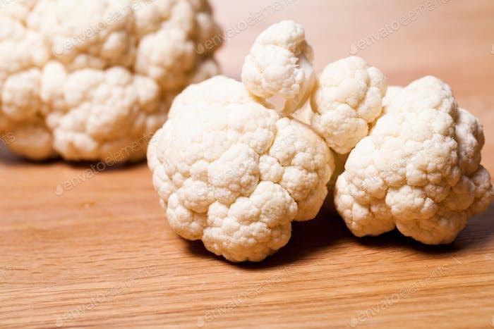 Fresh cauliflower on wooden surface